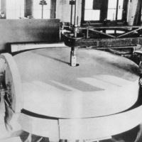 Mirror blank  set up on grinding table, with John Brashear in his Pittsburgh optical shop